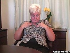 Obese granny with regard to stockings plays with vibrator