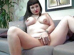 Carrie Ann is a ebony haired tattooed milf almost chunky