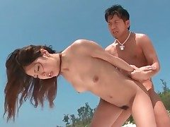 Doggystyle fuck-a-thon on the beach with Japanese girl