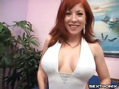 Milf redhead with an awesome set of melons inhales cock