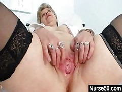 Busty granny in uniform stretching her aged vag