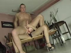 Brunette sucks cock and then uses a strapon at hand fuck his ass